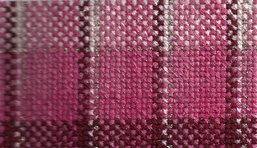 birthday plaid in cross stitch, stitched by Janet Perry